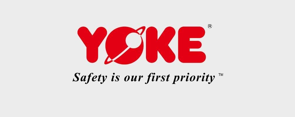 A red logo of the word YOKE and the slogan Safety is our first priority