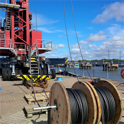 A close up of a mobile dock crane during a steel wire rope replacement