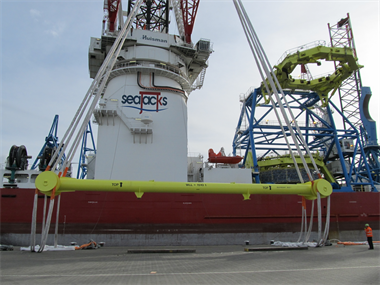 A Lifting spreader beam on an offshore vessel suspended at height